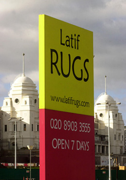 Latif Rugs outdoor Totem sign - Rugs direct to the public at wholesale prices - Modern rugs, Shaggy, Sheepskin, Persian, Needlepoint and many others. Buy Rugs Online.